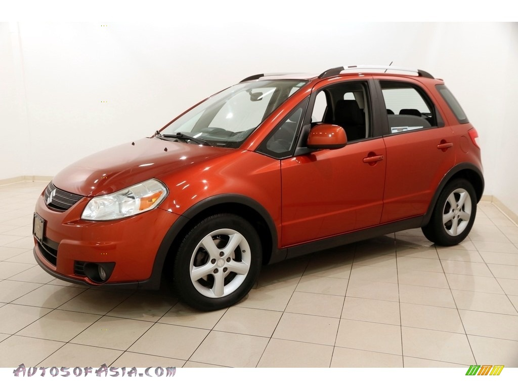 2009 SX4 Crossover Touring AWD - Sunlight Copper Metallic / Black photo #3