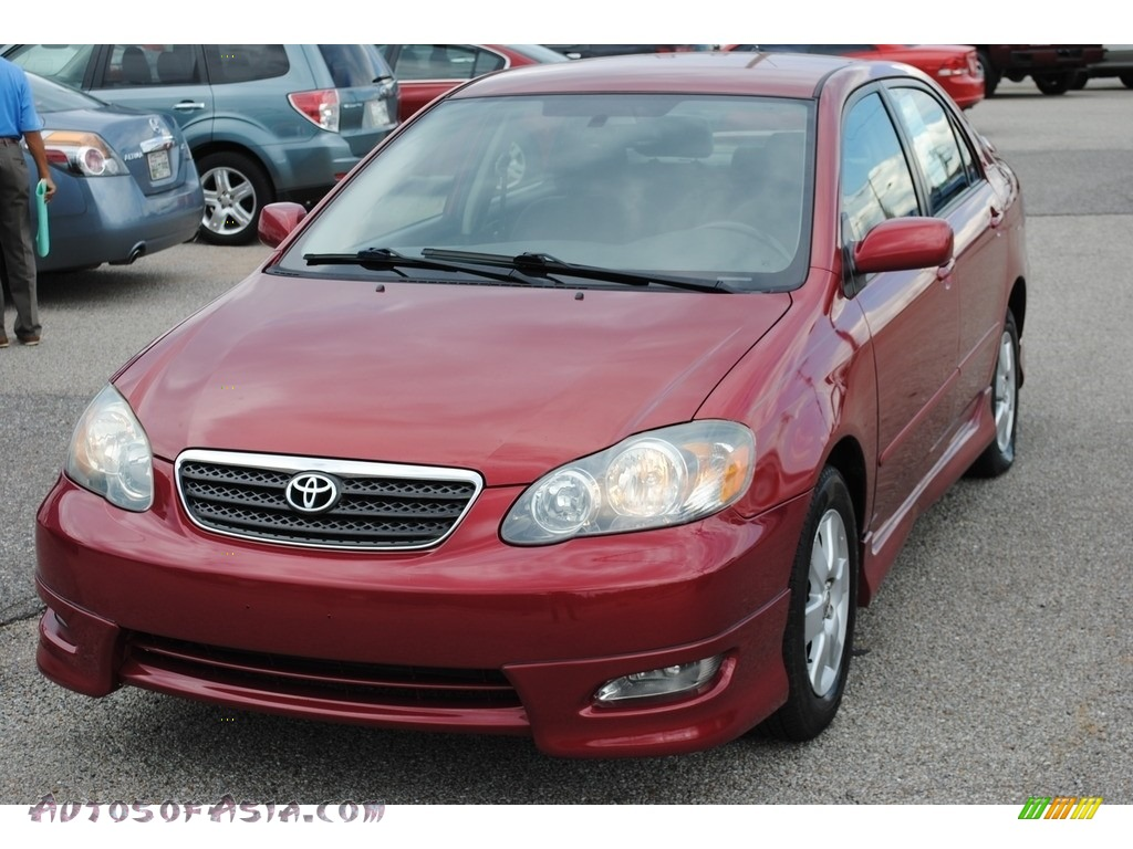 Impulse Red Pearl / Dark Charcoal Toyota Corolla S