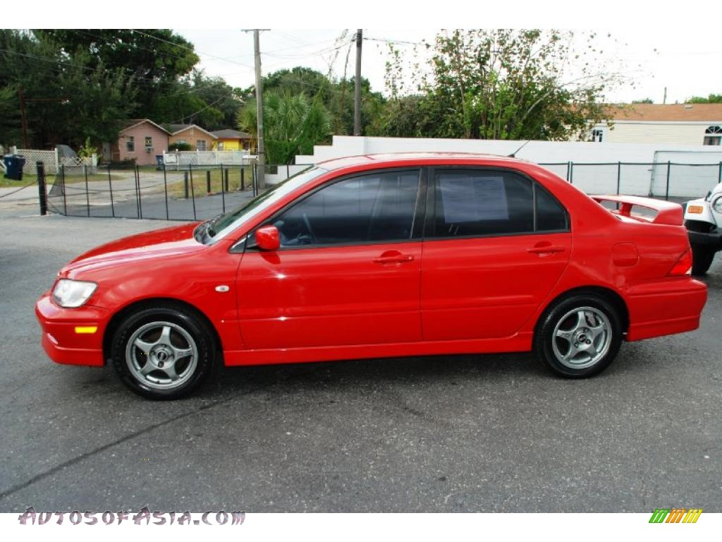 2003 mitsubishi lancer oz rally in phoenix red photo 2 046278 autos of asia japanese and. Black Bedroom Furniture Sets. Home Design Ideas