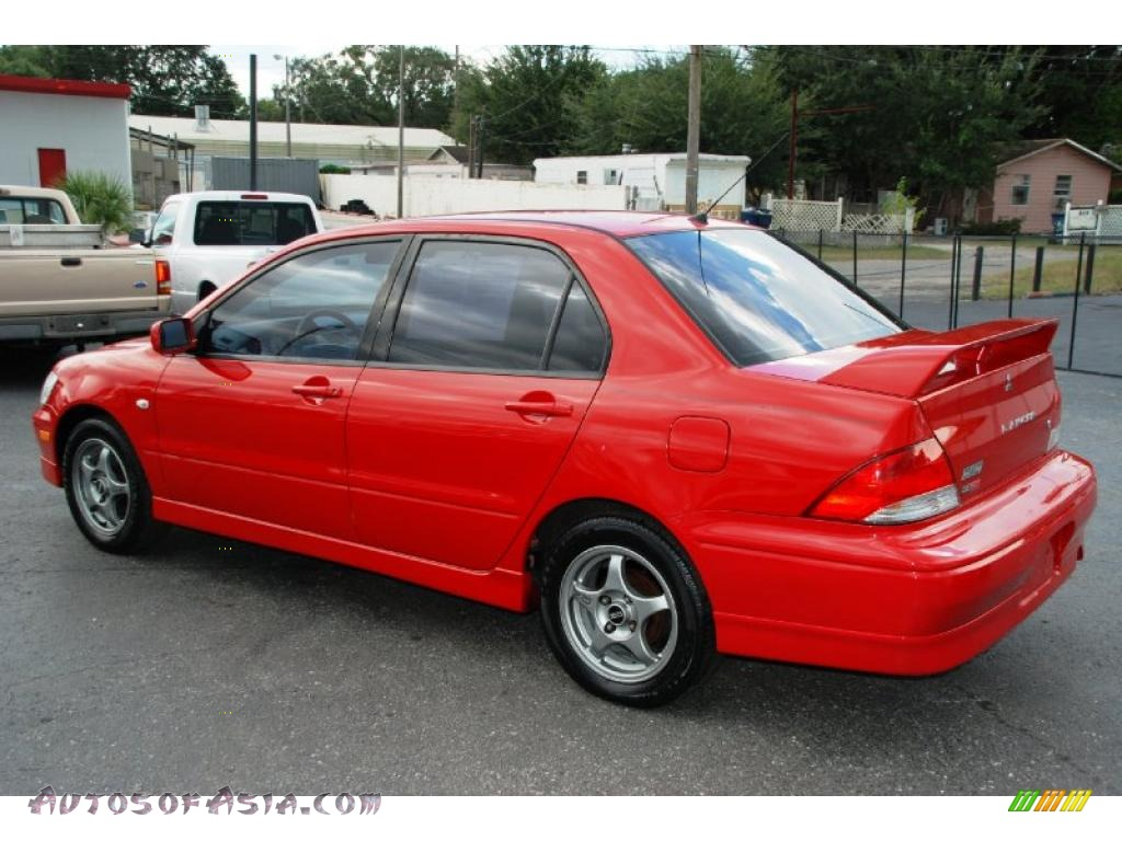 2003 mitsubishi lancer oz rally in phoenix red photo 9 046278 autos of asia japanese and. Black Bedroom Furniture Sets. Home Design Ideas