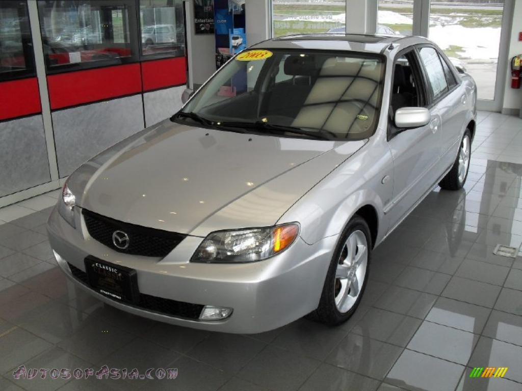 Sunlight Silver Metallic / Off Black Mazda Protege ES